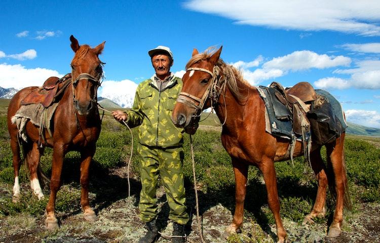 man holding horses - Mongolia Horse Trek