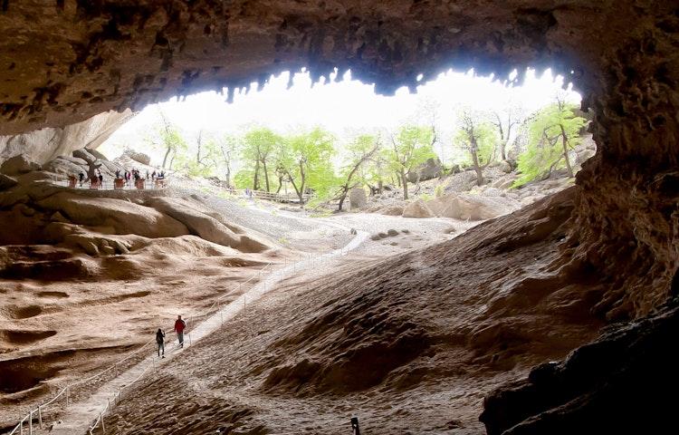 hikers in the cueva del milodon