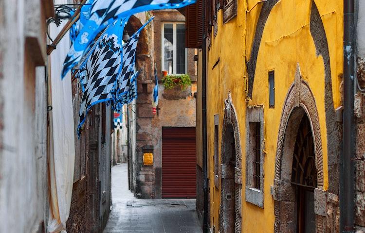 flags in orte - Italy Coastal Puglia Hiking