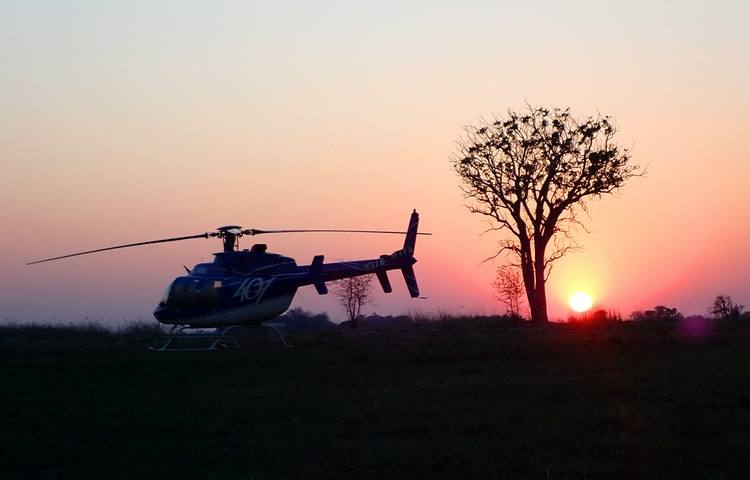 helicopter at sunset - Angola Expedition