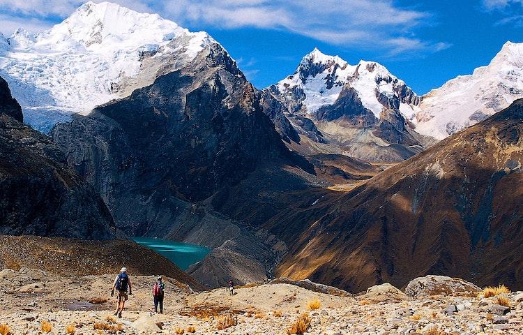 hikers descending into deep valley