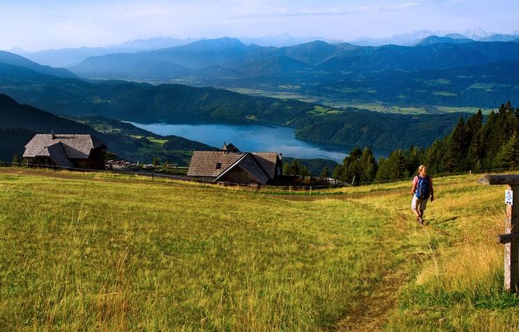 woman hiking down to lake - Austria, Italy & Slovenia Alpe Adria Hiking