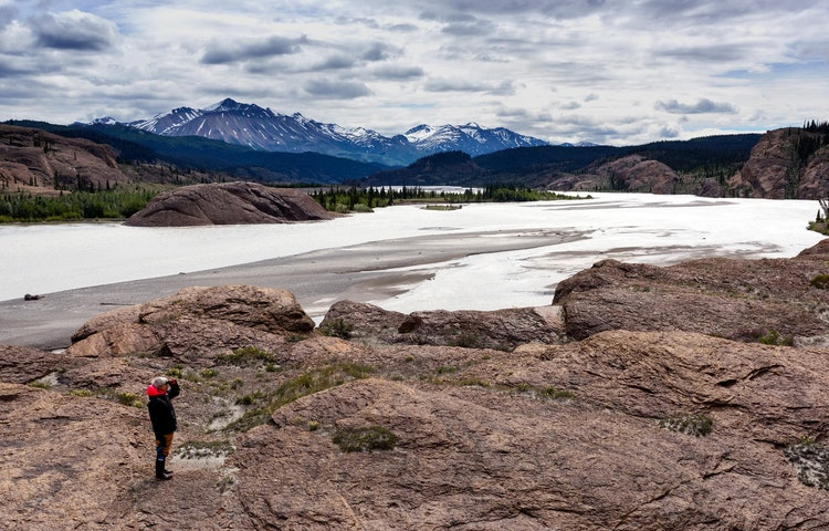 person by river - Alaska Alsek River Rafting