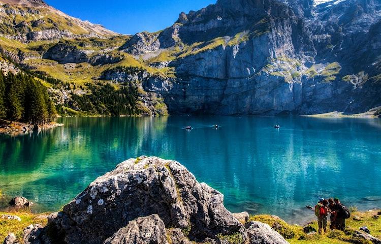 hikers at lake - Switzerland Bernese Oberland Trek