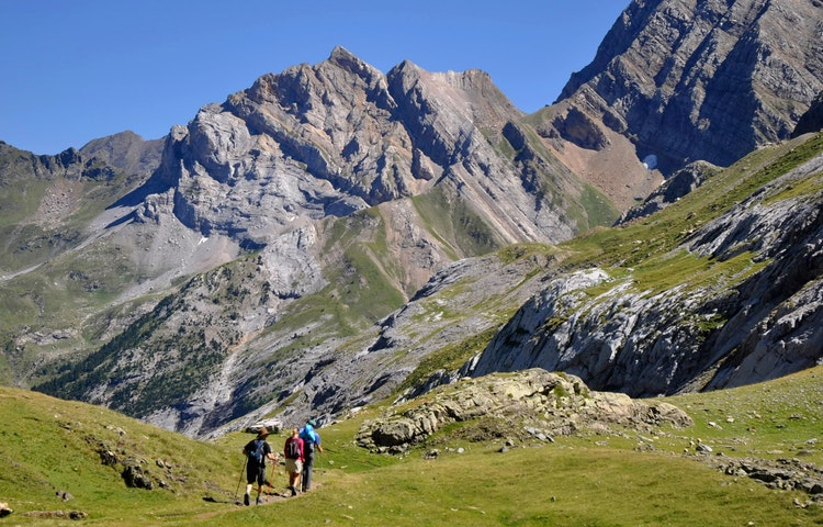 hikers approaching gavarnie - Spain & France Across the Pyrenees Hiking