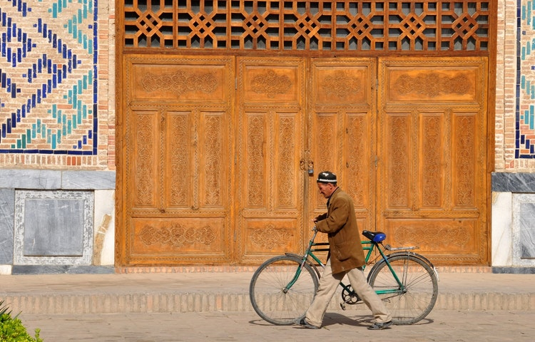 man on bicycle - Uzbekistan and Turkmenistan Silk Road Cultural Discovery