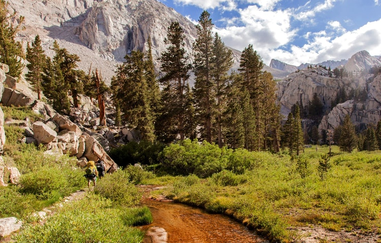 hikers by stream - California John Muir Trail Southbound to Mt. Whitney Trek