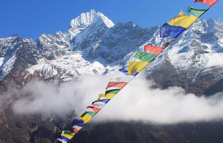 peak and prayer flags - Hiking in Nepal: Everest Lodge-to-Lodge Trek