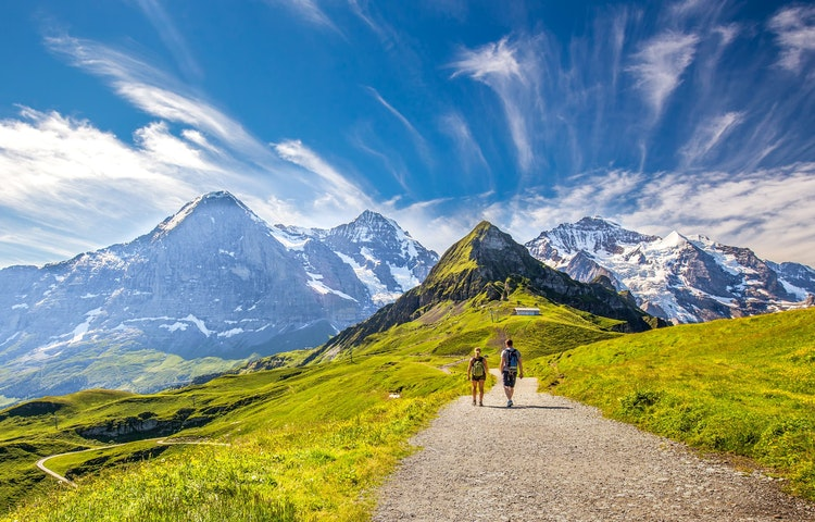 two hikers on road