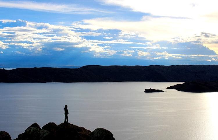 lone hiker at lake titicaca