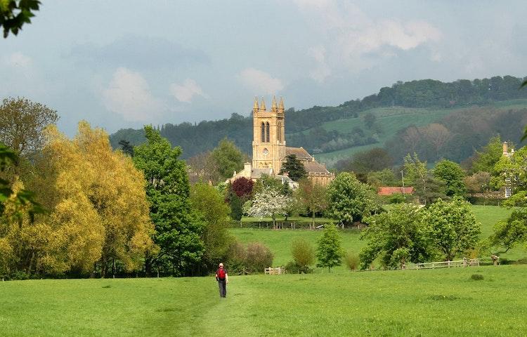hiker and church steeple