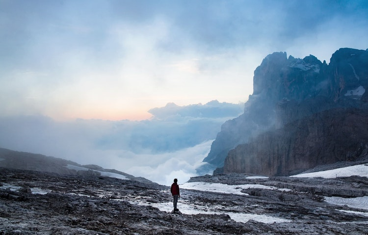hiker on misty morning