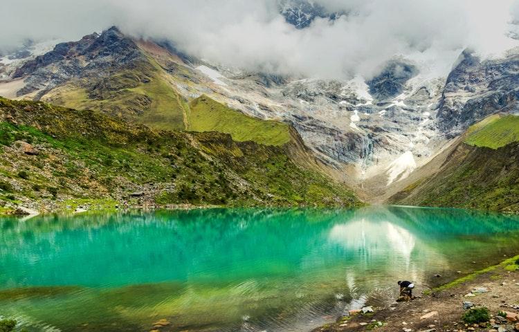 man at humantay lake - Peru Cusco and Machu Picchu Trek