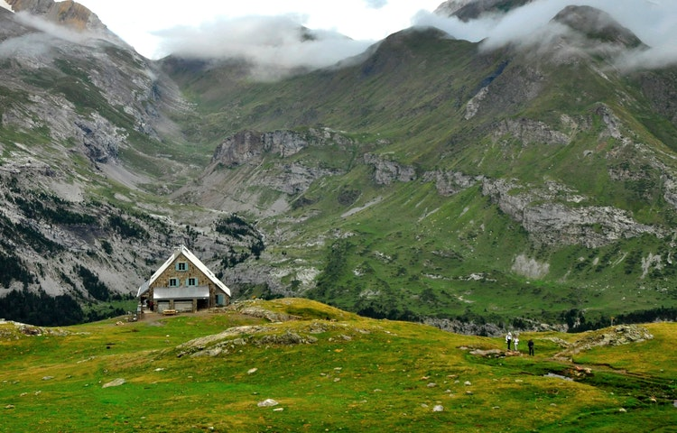 hikers leaving mountain hut