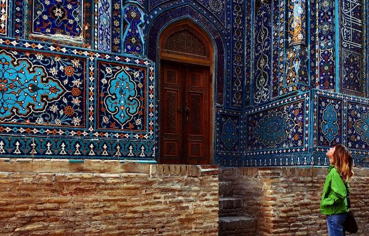 tourist gazing at tilework - Uzbekistan and Turkmenistan Silk Road Cultural Discovery