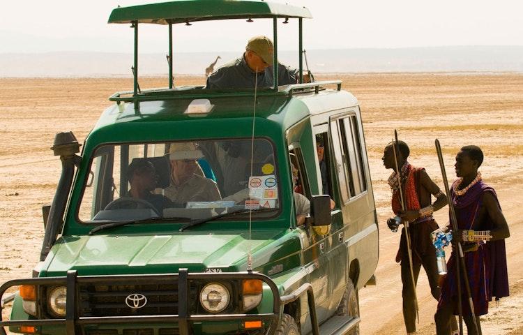 maasai and vehicle - Tanzania and Kenya Classic Safari Private Adventure