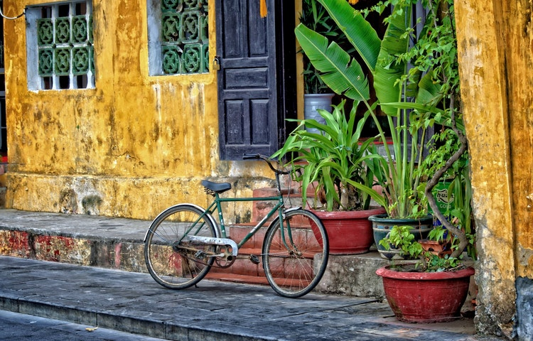 bicycle and yellow wall - Laos, Cambodia & Vietnam Indochine Cultural Discovery