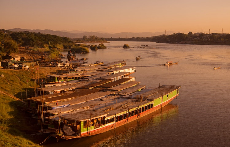 longboats - Highlights of Laos Private Adventure